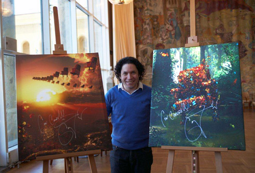 Gustavo Dudamel with two of the three pictures signed by him for auction on eBay. Photo: © 2010 Anna Hulth, Gothenburg.